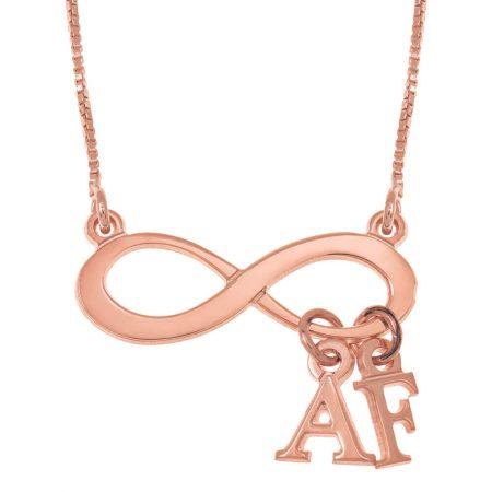 Infinitye Halskette mit baumelnden Initialen