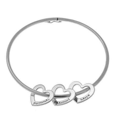 Armreif-Armband mit Herzanhängern